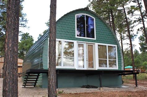 prefab arched cabins provide cozy homes