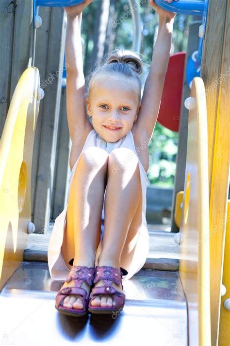 girl playing   playground stock photo  iuliia