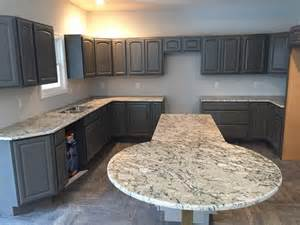 White Ice Granite Countertops with Gray Cabinets