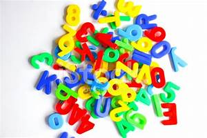 magnetic letters on white background stock photos With white magnetic letters