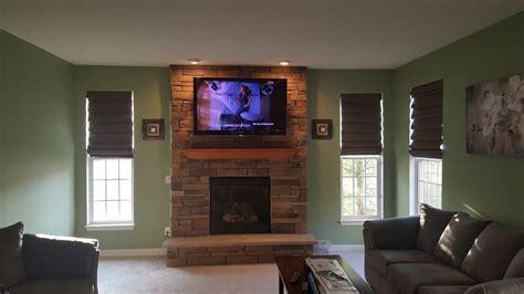 tv wall mounting tv fireplace installation setup