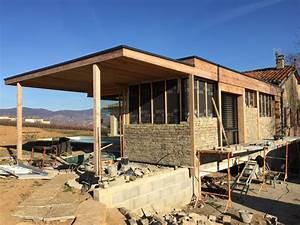 parement pierre sur ossature bois maison design mail With extension maison en l 17 mur en pierre sache de pierres et de bois