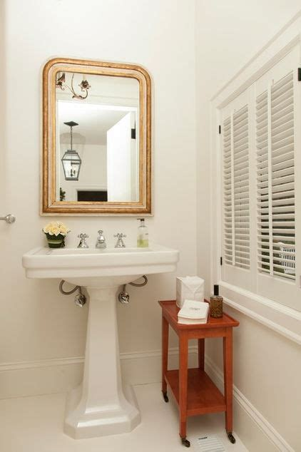 small table next to pedestal sink bathroom