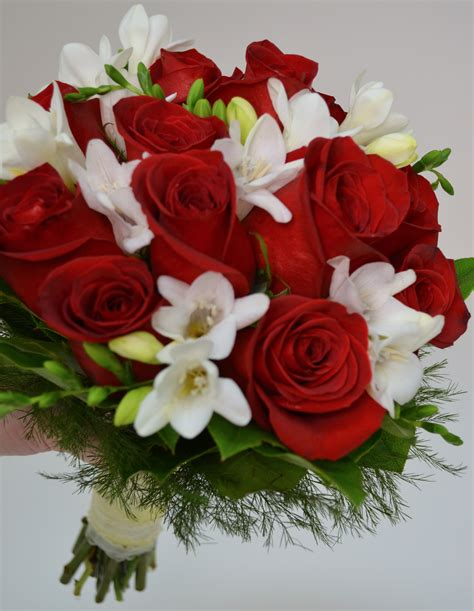 red rose white freesia bridesmaid bouquets id