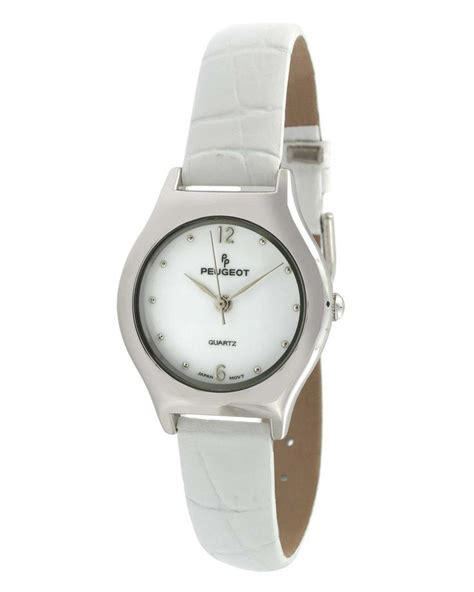 Vintage Peugeot Watches vintage white leather peugeot watches window shopping