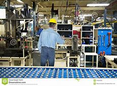 Man Working In Industrial Manufacturing Factory Stock