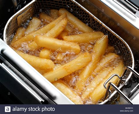 chips deep fat frying alamy
