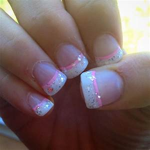 White French manicure with a twist, silver glitter, and a ...