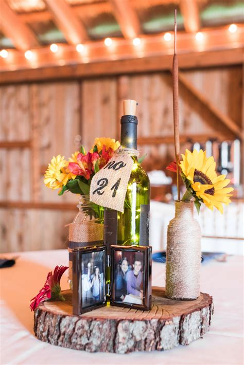 Rustic barn wedding reception decor wine bottles and