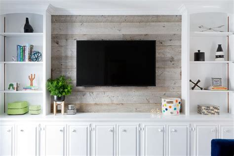built in tv cabinet television on barn board wall transitional living room