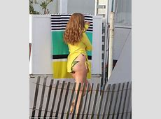 Amy Adams shows off cleavage as she slips into bright