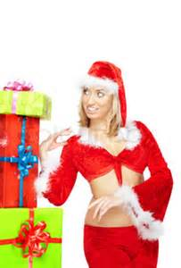 Smiling lady in Santa Claus costume standing near the