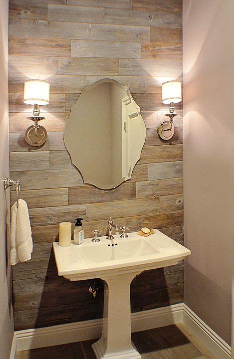powder room reclaimed wood wall chrome sconces pedestal