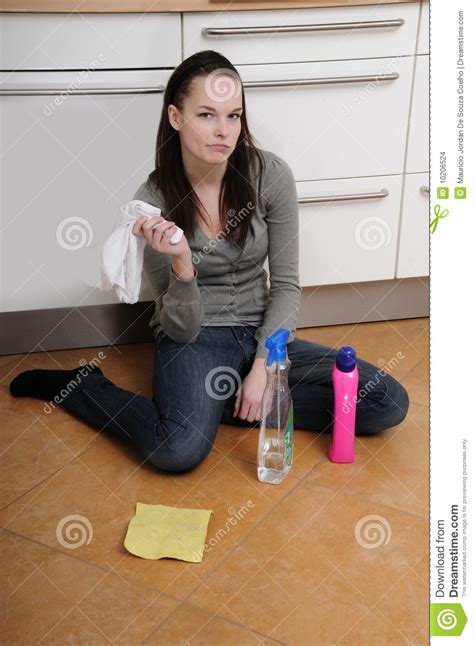 woman cleaning  kitchen floor stock images image