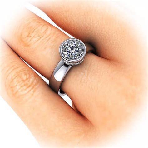 Bezel Set 8 Mm Moissanite Solitaire Engagement Ring. .925 Engagement Rings. 1.31 Carat Engagement Rings. Spanish Style Wedding Rings. Knot Engagement Rings. .92 Carat Engagement Rings. Untreated Rings. Custom Wedding Rings. Wrap Around Band Engagement Rings