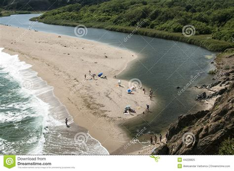 how is sand that flows in a river formed mouth of the river on seacoast stock photo image 44228825