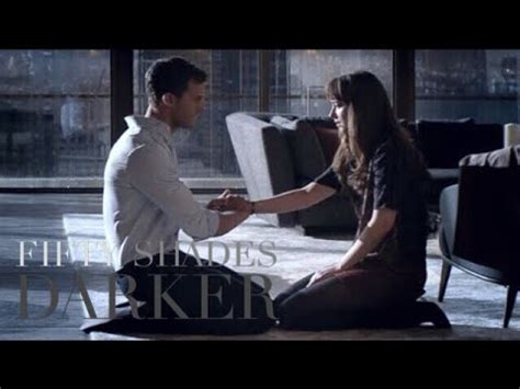 fifty shades darker christian kneels  ana