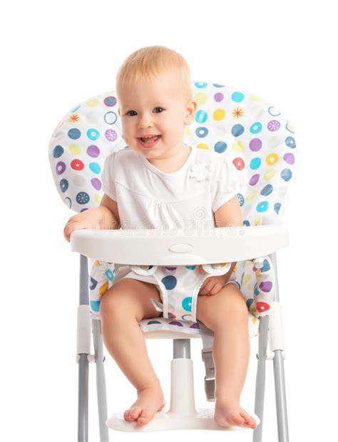 baby sitting in a high chair isolated stock image image