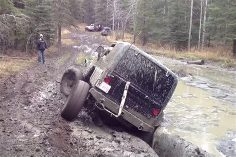 jeep stuck in mud meme video jeep gets stuck in mud has no option but to go for