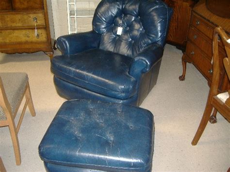 blue leather wingback chair and matching ottoman