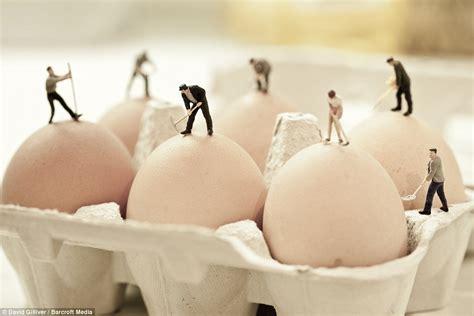 david gillivers photographs depict tiny figures slaving