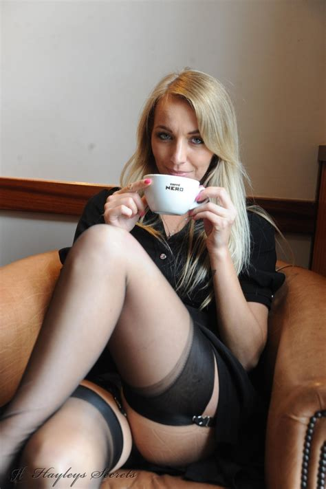 Hayley Marie flashing her stocking tops in a local cafe - British Babe Galleries