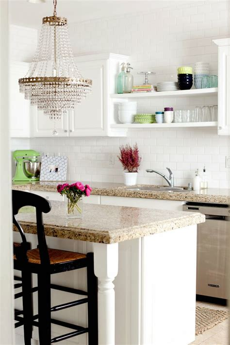 chandelier in the kitchen subway tile open shelves