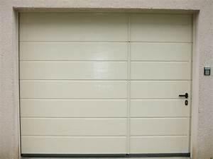 porte garage motorisee obasinccom With pose de porte de garage sectionnelle motorisée