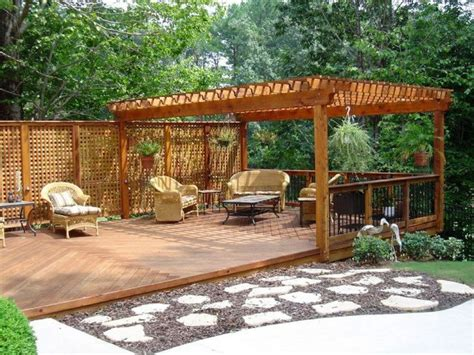 backyard deck plans here s a ground level deck with a pergola and a lattice