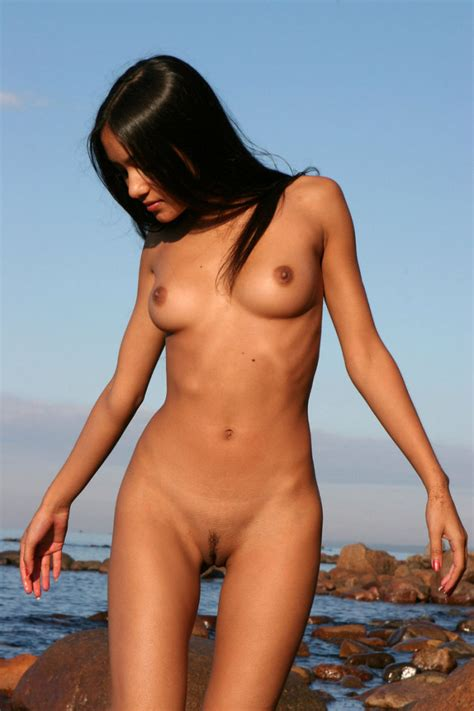 beautiful sporty brunette on rocky beach russian sexy girls