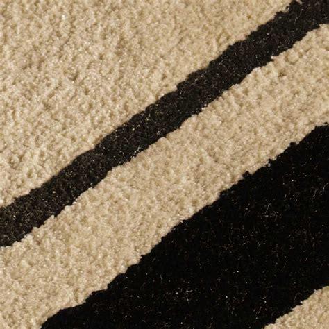 tapis beige  noir en viscose rectangulaire  motifs
