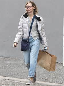 Calista Flockhart dons jeans and glasses for a casual