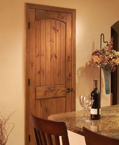 staining pine doors knotty pine panel arch doors we re putting throughout the