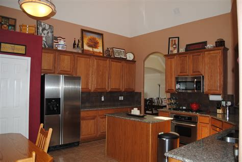 accent wall ideas for kitchen red accent wall in kitchen with brown cabinets google search country kitchens pinterest