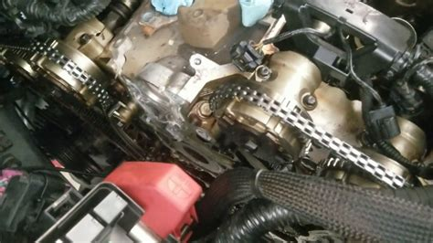 vehicle gm  vvt timing chain replacement code