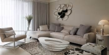picturesque modern living room with sectional beige couch