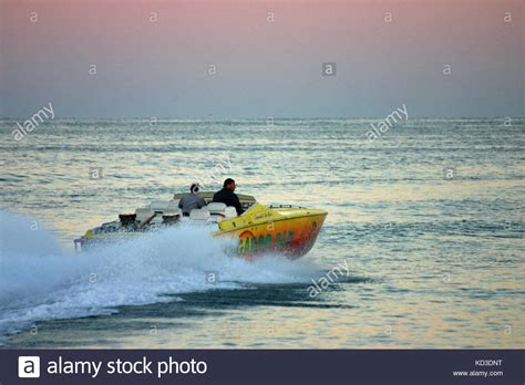 Yellow Cigarette Boat by Cigarette Boat Stock Photos Cigarette Boat Stock Images