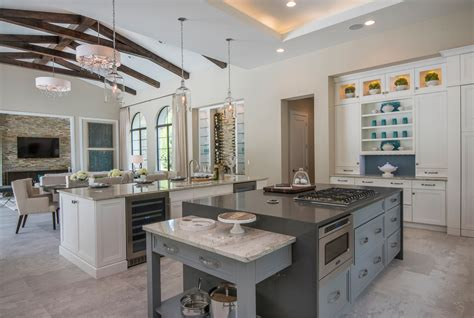 modern vaulted ceiling kitchen living room design with white and gray interior color decor and