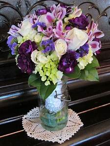 Wedding bouquet. Green hydrangea, white Roses, dark purple ...