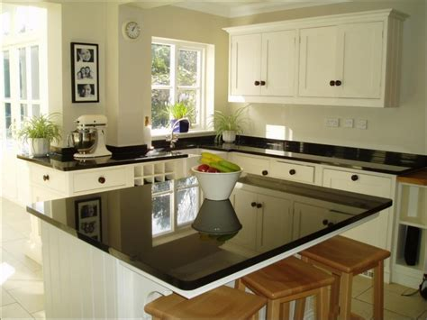 black kitchen island with granite top 5 ways to make your kitchen look bigger affordable 9300