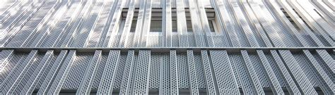 Facade systems with metal panels