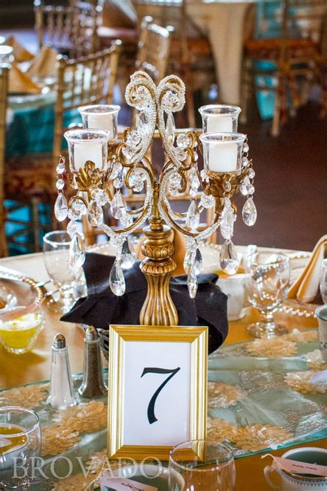 gold candelabra centerpiece at wedding reception from