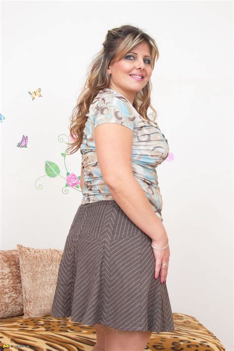 overweight housewife in skirt and blouse is seduced into