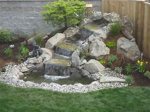 Landscape design advice creating natural waterfall in for Waterfall design ideas