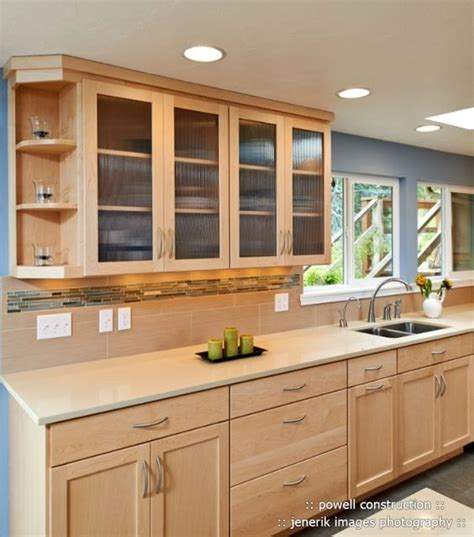 maple cabinets with caeserstone desert limestone