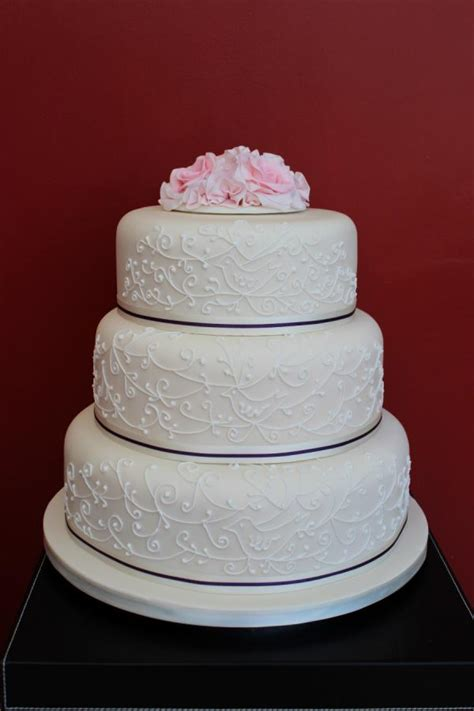 ivory  tier wedding cake  piping  pink roses