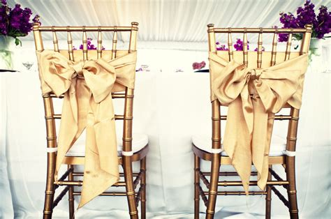 wedding reception groom chairs gold bows