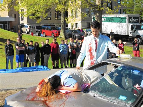mock car crash drives home dangers  distracted driving courant community