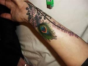 peacock feathers tattoos meaning