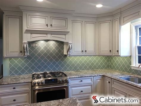 bright white cabinets paired  aqua backsplash  stainless steel appliances cabinets